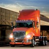 NAVISTAR TAKES A HIT BUT SAYS BETTER DAYS ARE AHEAD