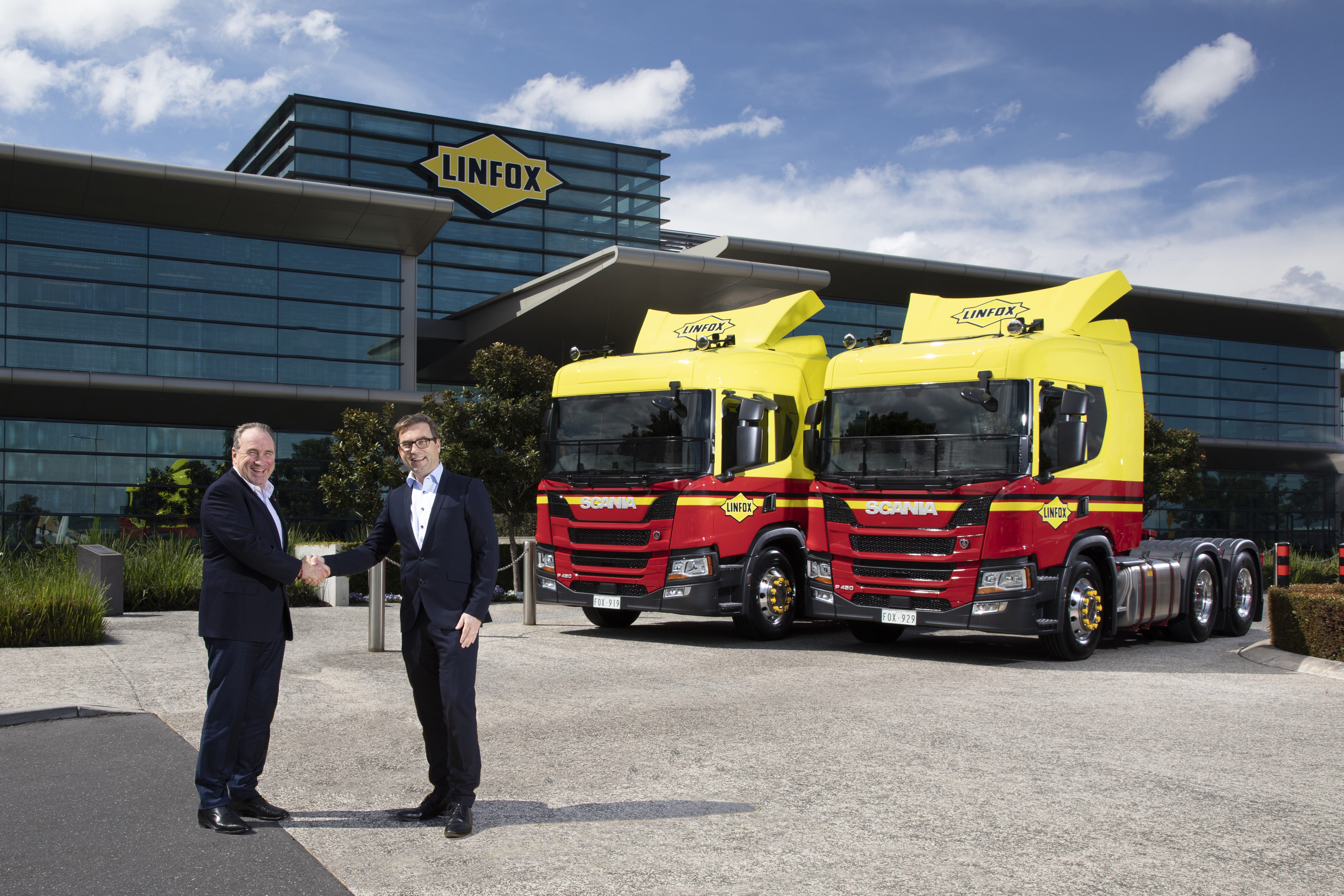Peter Fox takes delivery from Mikael Jansson of the first Scania NTG P 450 Euro 6 prime movers