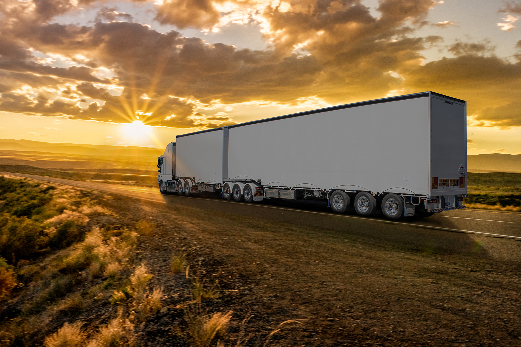 Semi-Truck on an Interstate Highway at Dusk with Cloudscape